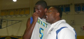 "Grant High coach Deonard Wilson consoles his star player De""Sean Parson after the Pacers were beat by Sacramento High 77-52 on March 9."