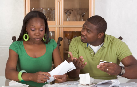 black couple frustrated paperwork