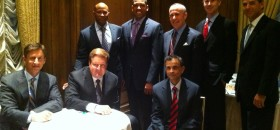 Sacramento Mayor Kevin Johnson, standing second to left, and Sacramento City Councilman Allen Wayne Warren, standing far left, take a photo with representatives that made a presentation to the NBA in hopes of keeping the Sacramento Kings in town.