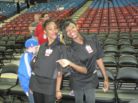 Brittany Jones, left, and Courtney Ewing, right, new employees at Sleep Train Arena, show off their smiles and new uniforms on Oct. 23, 2013. All of the employees at the facility were fitted with new uniforms to start the upcoming NBA season. The new owners of the Kings saved about 800 jobs that would have been lost had the team relocated from Sacramento to Seattle. OBSERVER Photo by Antonio. R. Harvey