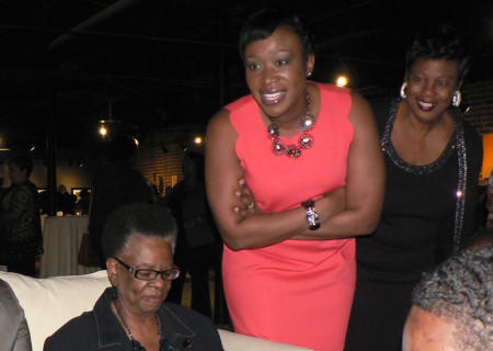 "MSNBC contributor and national journalist Joy-Ann ""Joy"" Reid, wearing red dress, meet with guests at Sacramento's Evolve the Gallery last month. Reid's appearance was hosted by the Sacramento Chapter of 100 Black Women Incorporated. OBSERVER photo by Antonio R. Harvey"