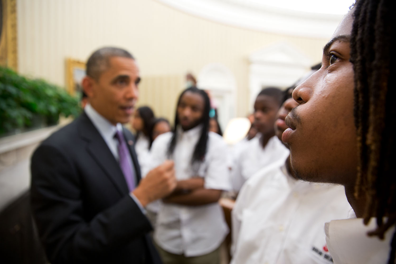 President Barack Obama visits with students and counselors from William R. Harper High School in Chicago, Ill., in the Oval Office, June 5, 2013. First Lady Michelle Obama met with the students in April 2013 to discuss youth violence. (Official White House Photo by Pete Souza) Students from William R. Harper High School in Chicago, Ill., listen as President Barack Obama talks with them about the Emancipation Proclamation hanging in the Oval Office, June 5, 2013. (Official White House Photo by Pete Souza)