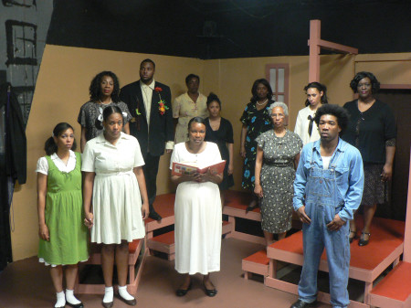 The story is melancholy, though the cast members of Toni Morrison's 'The Bluest Eye' are magnificent. Shown in the front row, left to right, Eliza Hendrix, Brooklynn Solomon, Carol Jefferson, Debbie Reeves, and Zarati Depaz. Back row, L-R, Madres Story, Tarig Elsiddig, Jannette McCoy, Marivel Palone, Betty Cummings, Andrea Covington, and KT Masala. (OBSERVER photo by Antonio R. Harvey)