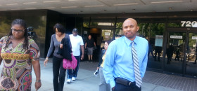 Richard Nelson Jr., right, leaves the Sacramento County Courthouse with family members on Aug. 20, 2014, after hearing that three men were convicted of killing his sister Monique R. Nelson on Dec. 14, 2014. Ms. Nelson died shielding her two-year-old son from a hail of gunfire outside of South Sacramento barbershop. (OBSERVER photo by Antonio R. Harvey)