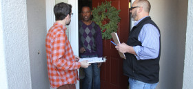 Darrow Sprague and Eric Sunderlund talk to a Natomas resident about signing the petition to call for a special election in the Twin Rivers Unified School District. The Democratic Party of Sacramento County said it collected the required signatures and met the deadline (OBSERVER photo by Robert Maryland).