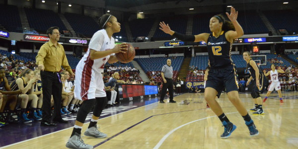 Oak Ridge's Isamar Conde, right, defends McClatchy's Alex Washington, left, during the D-1 Nor Cal Championships at Sleep Train Arena on March 21. McClatchy won the game 58-49 and will play for the state title next week in Berkeley. (OBSERVER photo by Antonio R. Harvey)