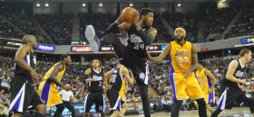 Jason Thompson pulls down a rebound against Los Angeles' Jordan Hill at Sleep Train Arena on April 13. The Kings beat the Lakers 102-92 at home, and then beat Los Angeles again on its floor 122-99 on April 15. (OBSERVER photo by Antonio R. Harvey)