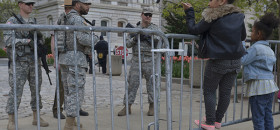 Two young girls talk to national guardsmen outside of city hall in Baltimore, Md., on Friday, May 1. (Freddie Allen/NNPA News Wire Service.)