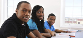 African American university students in a classroom.