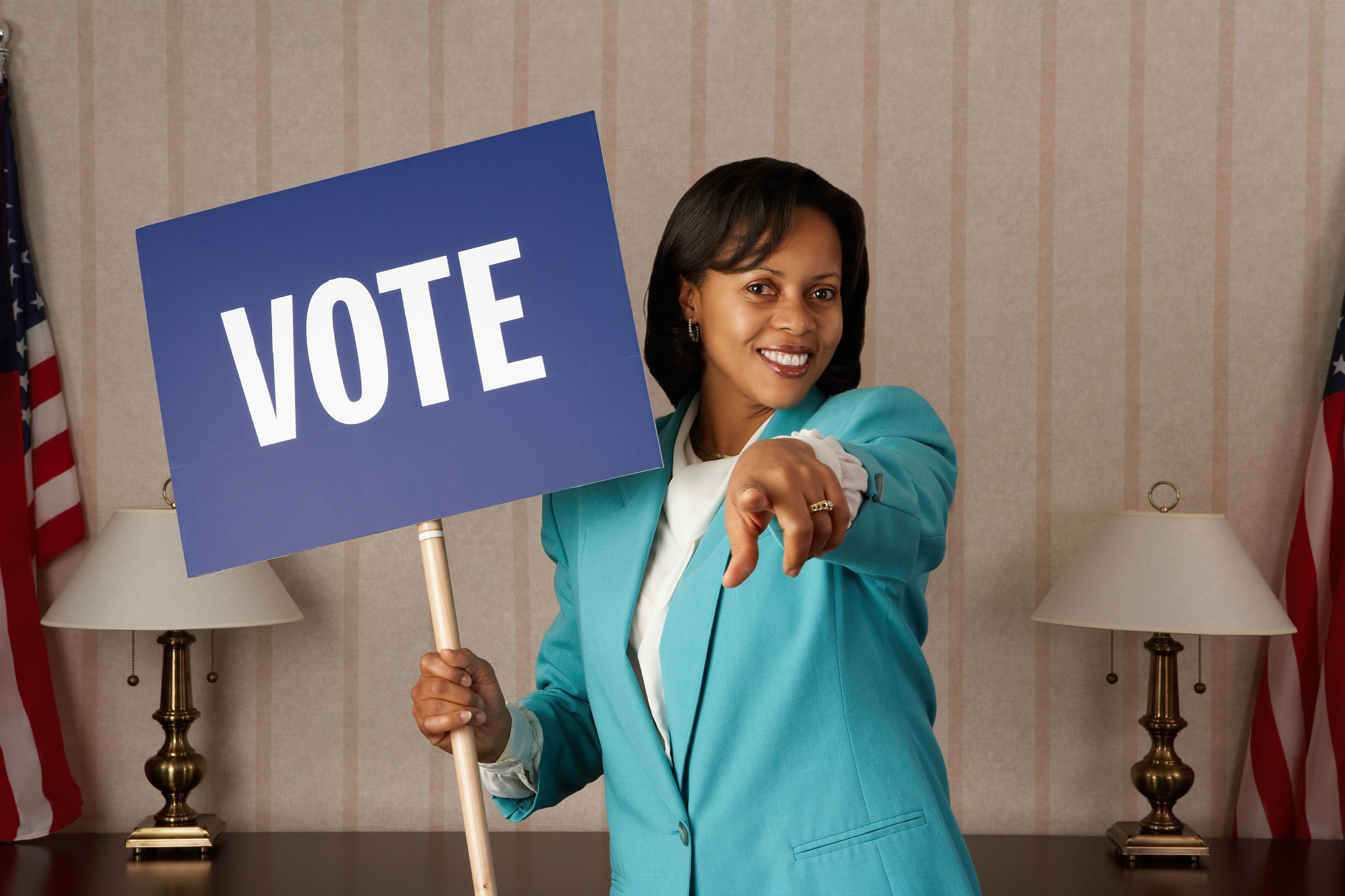 Politician woman holding Vote sign in office