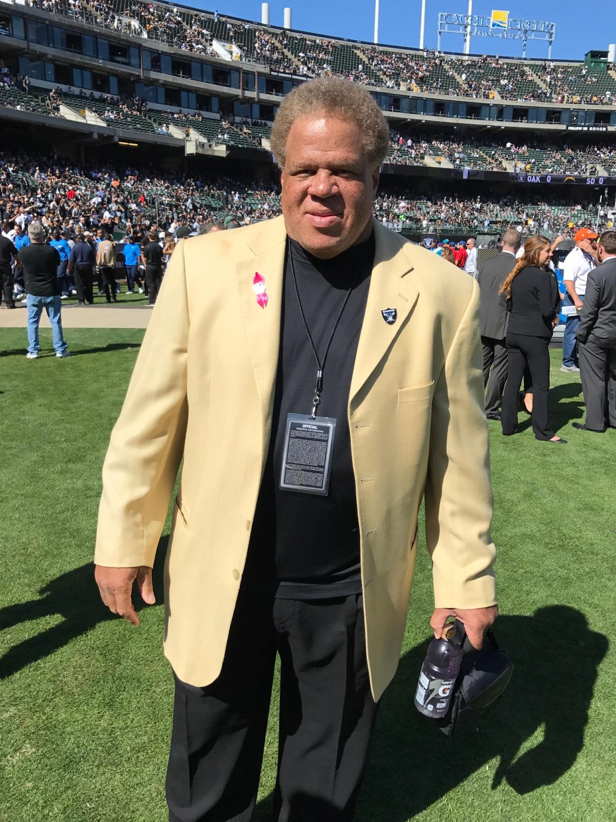 Reggie McKenzie, the General Manager for the Oakland Raiders, has a lot to smile about. His Bay Area team beat the San Diego Chargers 34-31 on Oct. 9 and improved to 4-1. (OBSERVER photo by Simeon Gant)