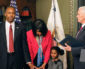 Dr. Ben Carson (left) was sworn in as the Secretary of Housing and Urban Development on Thursday, March 2.  Carson's wife along with his 5-year-old granddaughter, Tesora held the Bible. (Shevry Lassiter/The Washington Informer)
